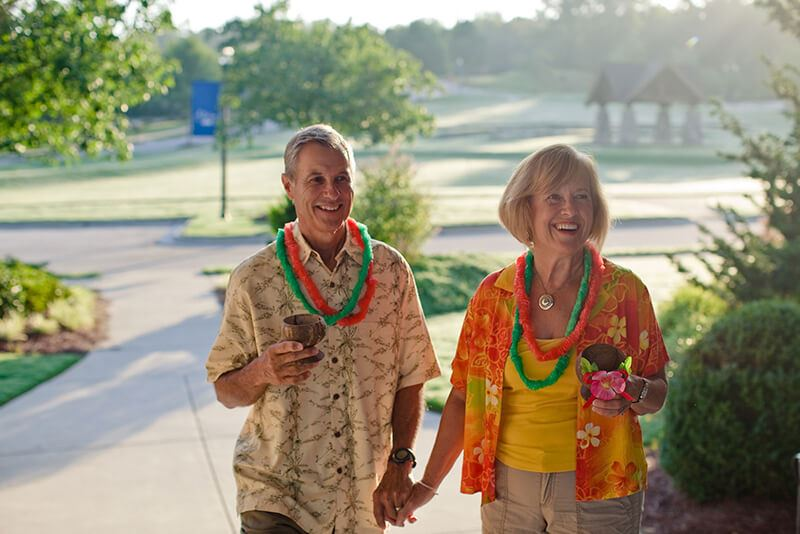 Couple attending luau at Sterling on the Lake Clubhouse
