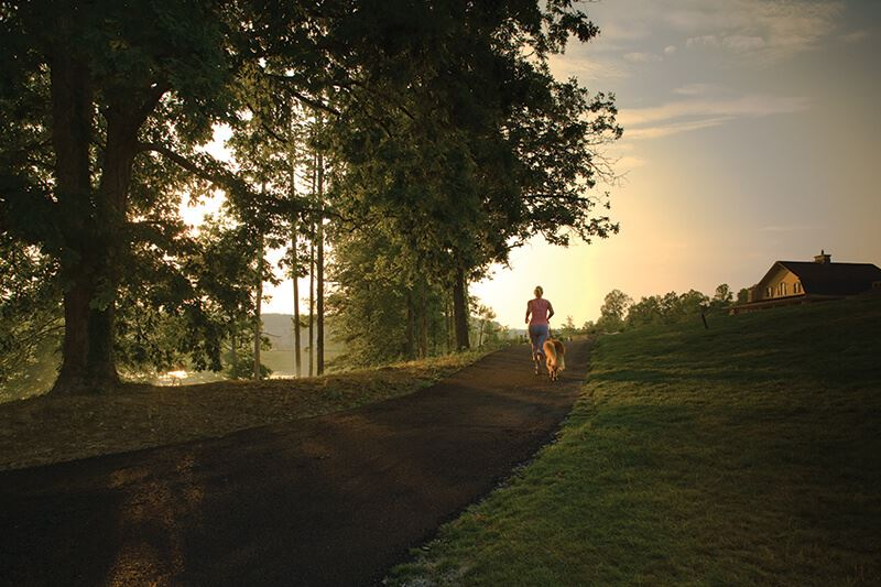 Running along trail at sunrise in Sterling on the Lake