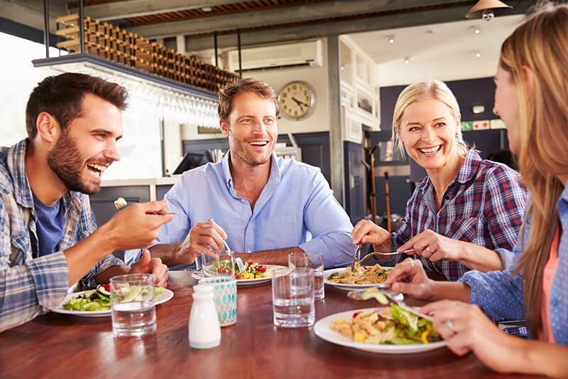 Young professionals dining in casual restaurant