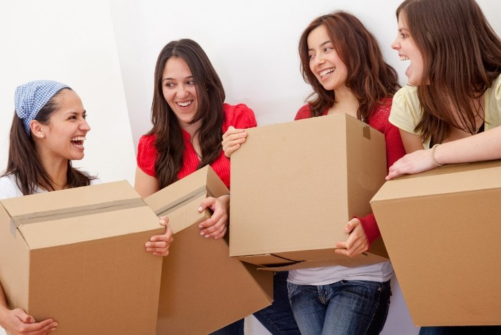 girls moving boxes