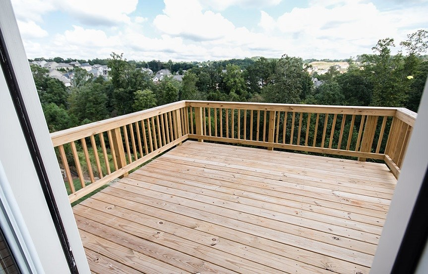 Outdoor deck facing the woods.