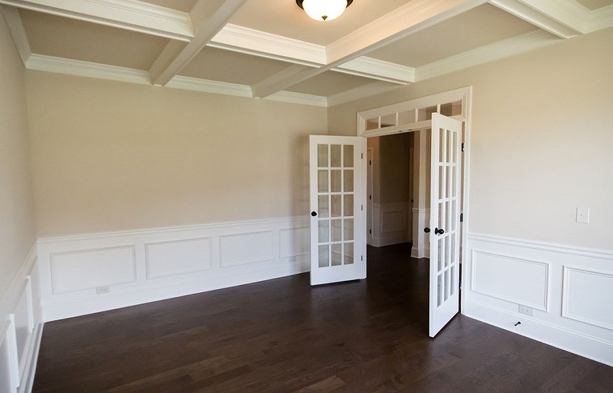Downstairs room with wood floors and french doors.