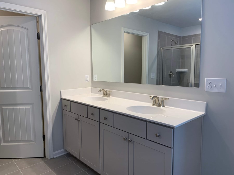 The Somerset plan at Sterling on the Lake view of master bathroom double sinks and grey cabinets.