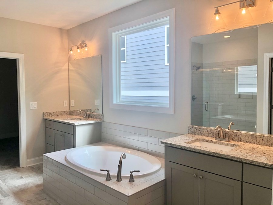 Belmont Master Bathroom Separate Granite Vanities and Tub