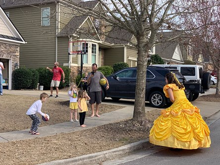 Woman dressed as Belle, visiting kids in Sterling on the Lake.