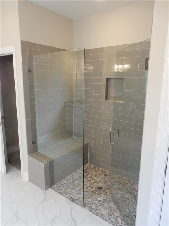 Vanderbilt Homes Belmont Primary Suite Shower in The Springs at Sterling on the Lake